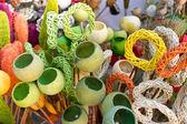 Colored wickerwork and poppy pods — Stock Photo