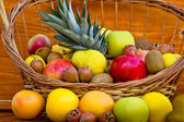 Fresh organic fruits in the wicker basket — Stock Photo