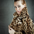 Stock Photo: Attractive woman in fur coat