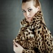 Stock Photo: Attractive womin fur coat