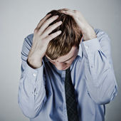 Businessman with a big headache — Stock Photo