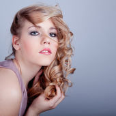 Sensuality and attractive young woman face with beauty hairs — Stock Photo