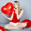 Valentines day woman holding red heart balloon — Stock Photo