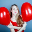 Valentines day woman holding red heart balloon. — Stock Photo