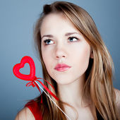 Young woman holding red heart in valentine's day — Stock Photo