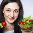 Pretty girl eating salad — Stock fotografie