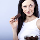 Portrait of beautiful woman with a chocolate — Stock Photo