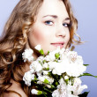 Happy young smiling woman with flowers — Stock Photo