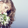 Sensual girl with flowers — Stock Photo