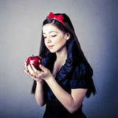 Fantasy portrait of the beautiful Snow White with an apple — Stock Photo
