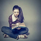 Teen girl reads a book — Stock Photo