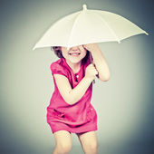 Funny little girl with umbrella — Stock Photo