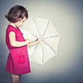 Beauty a little girl with umbrella — Stock Photo