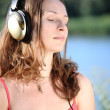 Cute woman listening to music — Stock Photo