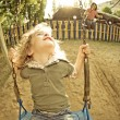 Child on swing in summer — Stock Photo #8139838