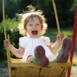 Child on swing — Stock Photo #8139932