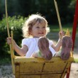 Playing on the swings — Stock Photo #8139936