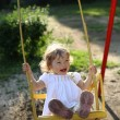 Playing on the swings — Stock Photo #8139942