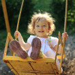 Playing on the swings — Stock Photo #8139945