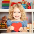 Happy child with paper heart - Stock Photo