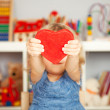 Happy child with red paper heart — Stock Photo