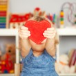 Happy child with red paper heart - ストック写真