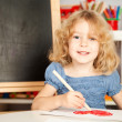 Stock Photo: Happy child painting heart