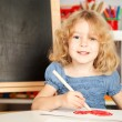 Happy child painting heart — Stock Photo