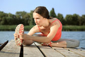 Woman doing stretching exercis — Stock Photo