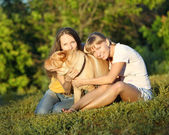 Two girls with dog — Stock Photo