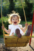 Child on swing — Foto Stock