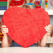 Happy child with paper heart — Stock Photo