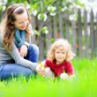 Woman and child in summer garden — Stock Photo
