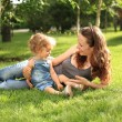 Woman with child in summer park — Stock Photo