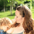 Lovely baby breastfeeding — Stock Photo #8140160