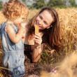 Stock Photo: Woman with child in field
