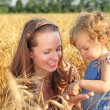 Woman with child in field - Stock Photo