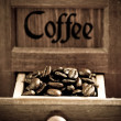 Coffee beans in grinder — Stock Photo
