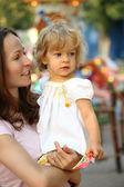 Family in amusement park — Stock Photo