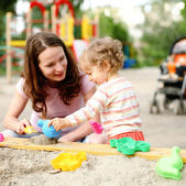 Family on playground — Stock Photo