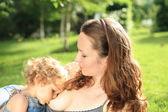 Lovely baby breastfeeding — Stock Photo