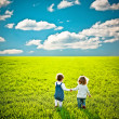 Children going on summer field - Stock Photo