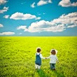Stock Photo: Children going on summer field