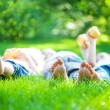 Children feet in green grass — Stock Photo
