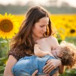 Woman breastfeeding baby — Stock Photo #8485448