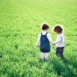 Stock Photo: Children in spring field