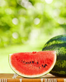 Juicy watermelon against natural background — Stock Photo