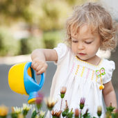 Child in spring garden — Stock Photo