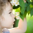 Child with jasmin flower — Stock Photo #9152086