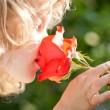 Beautiful child with flower — Stock fotografie